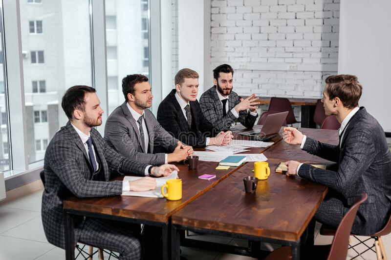 Young manager or boss talk with co-workers royalty free stock photography