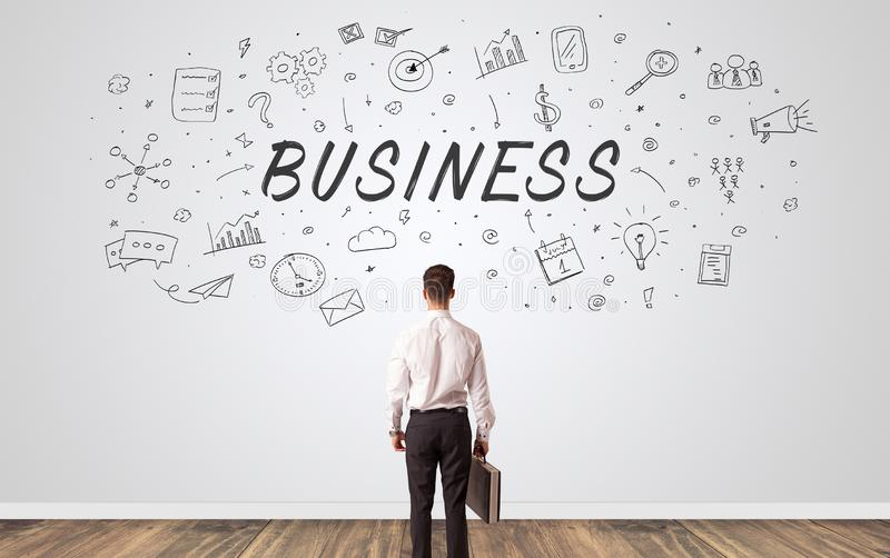Manager in doubt looking to a wall with business concept stock image