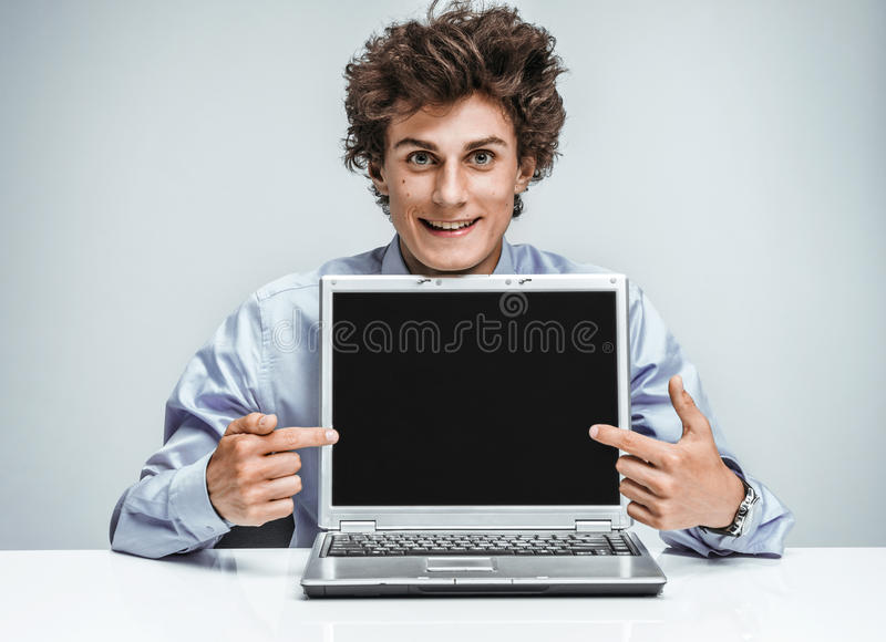 Young manager showing at screen laptop royalty free stock photo