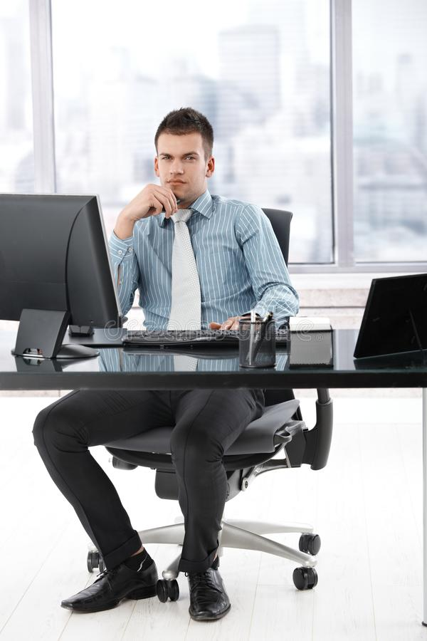 Young manager sitting in modern office stock photos