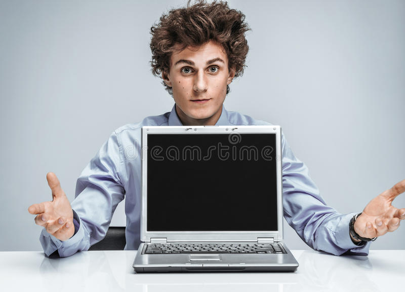 Young manager threw up his hands and in disbelief stock images