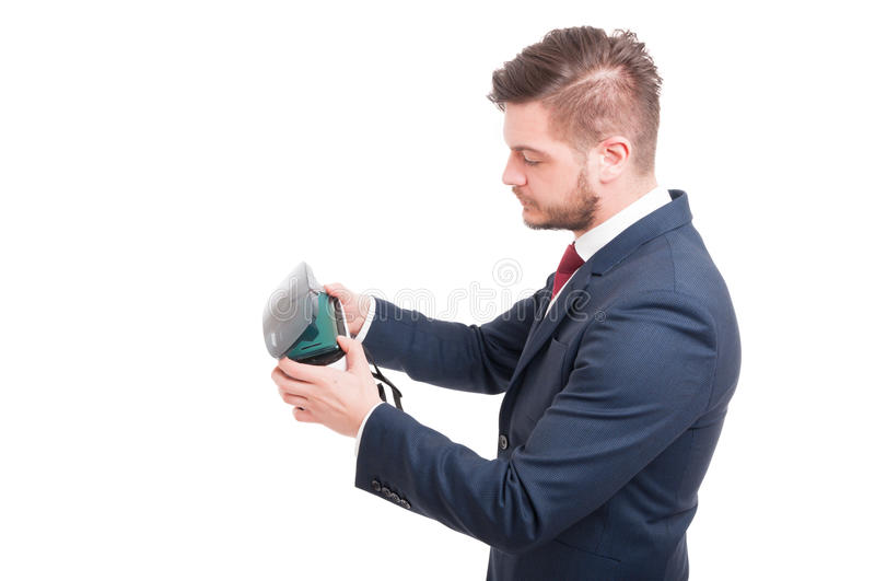 Young manager wearing virtual reality goggles. Getting ready to play isolated on white stock image