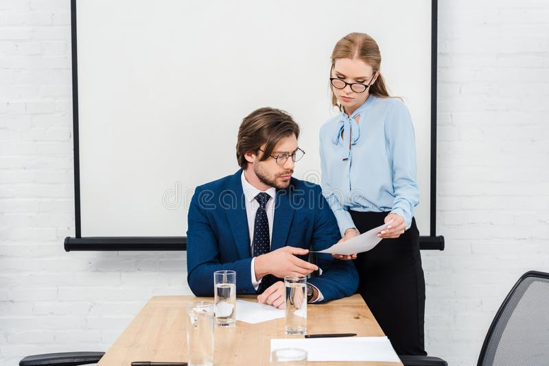 young manageress showing documents to her boss royalty free stock photos