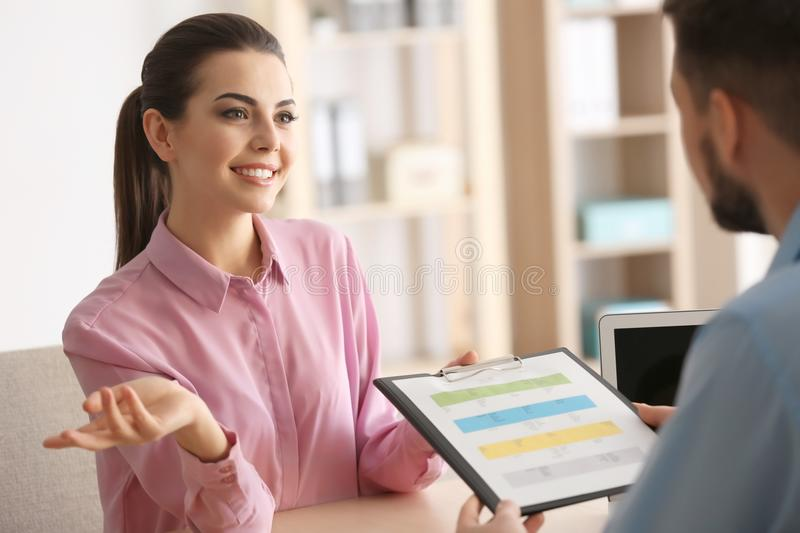 Young managers discussing issues. In office royalty free stock photos