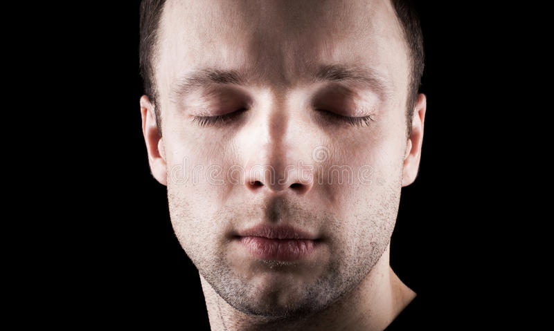 Young mans portrait with closed eyes stock photo