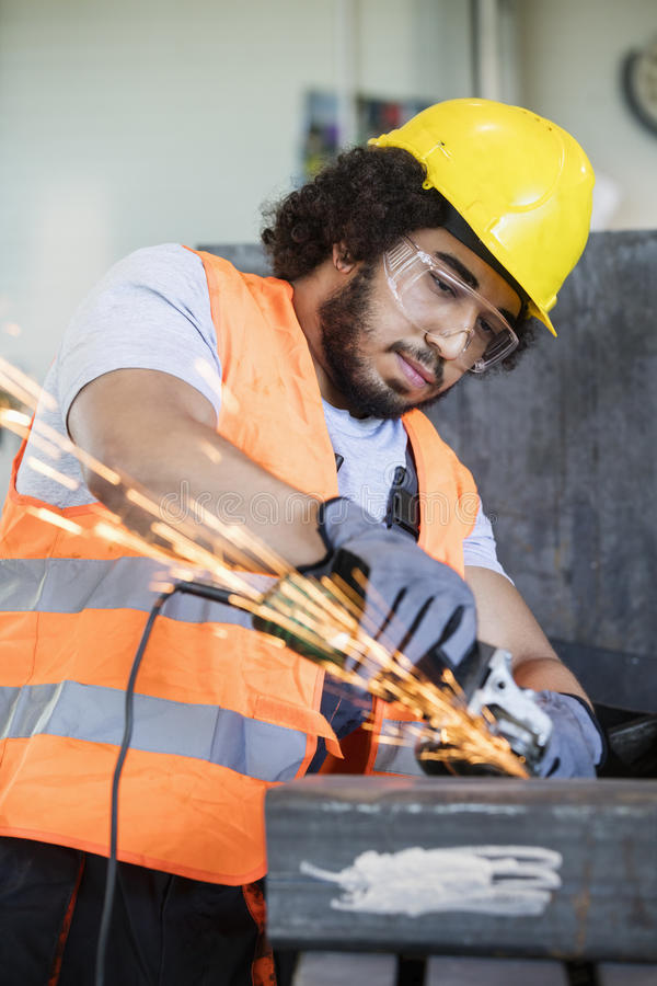 Free Young Manual Worker In Protective Workwear Grinding Metal In Industry Stock Photo - 78727400