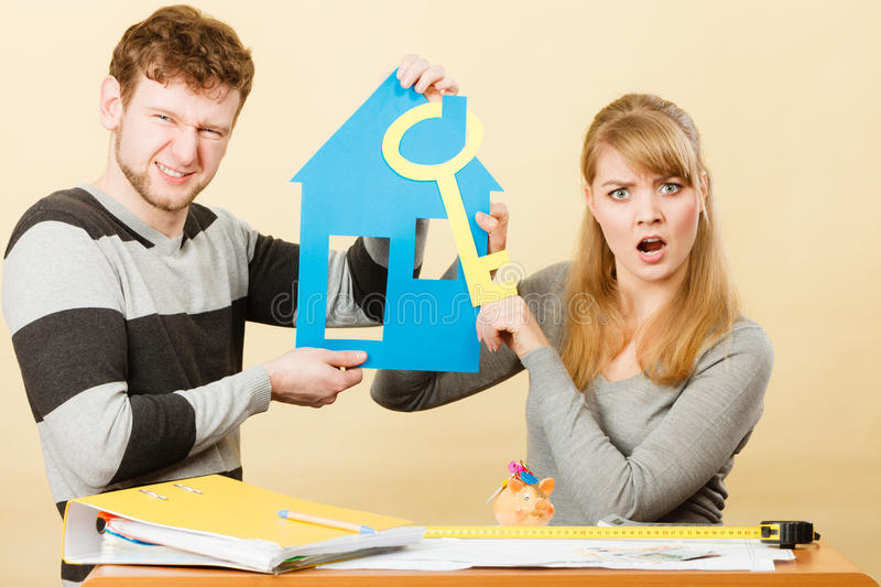 Young marriage arguing about first house buying. Advantages and disadvantages of living together. Young couple marriage arguing of new house home flat apartment stock image