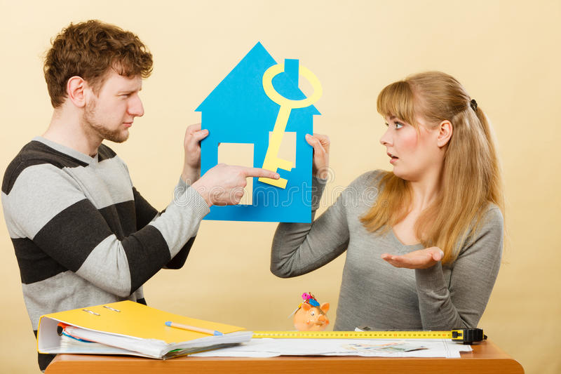 Young marriage arguing about first house buying. Advantages and disadvantages of living together. Young couple marriage arguing of new house home flat apartment stock photos
