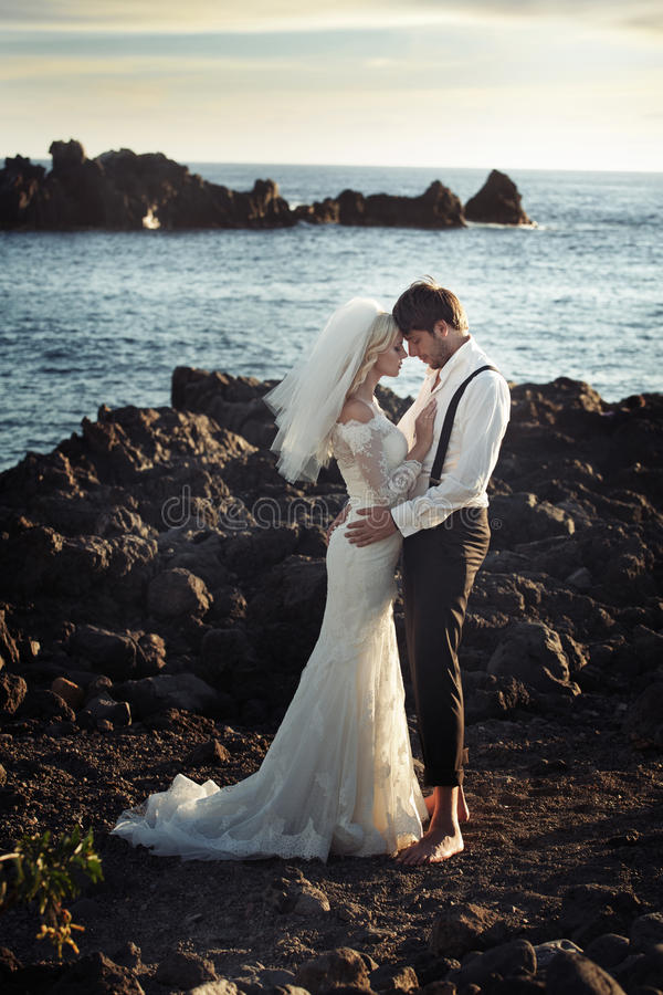 Young marriage couple over the ocean royalty free stock photos
