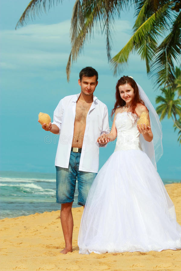 Young Married Couple On A Beach In A Tropical Destination Stock Images