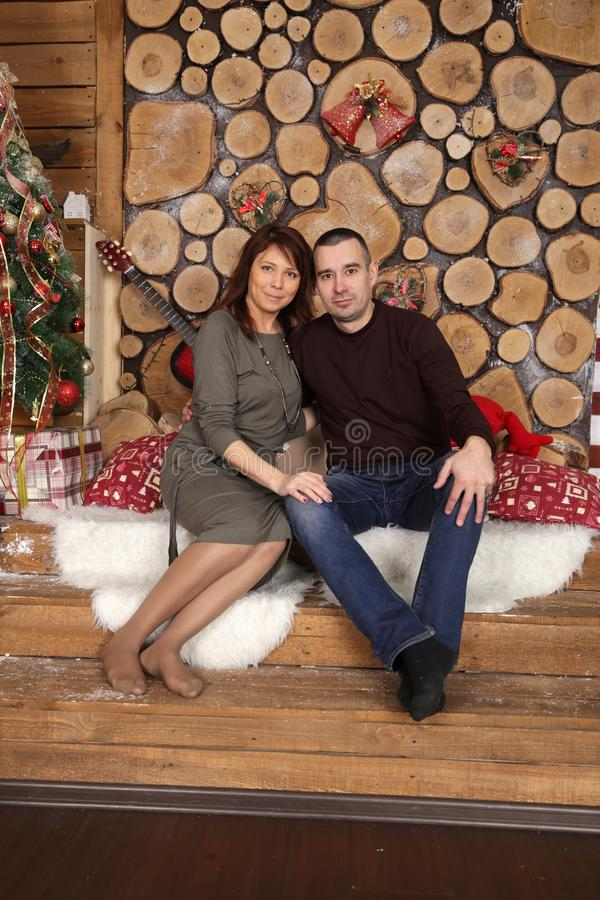 Amazing Christmas Gifts For Married Couples Young Part - 7: Young Married Couple At Christmas Tree With Gifts, Portrait In A Beautiful  Festive Interior