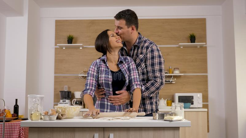 Young married couple cooking for the first time in their new home stock photography