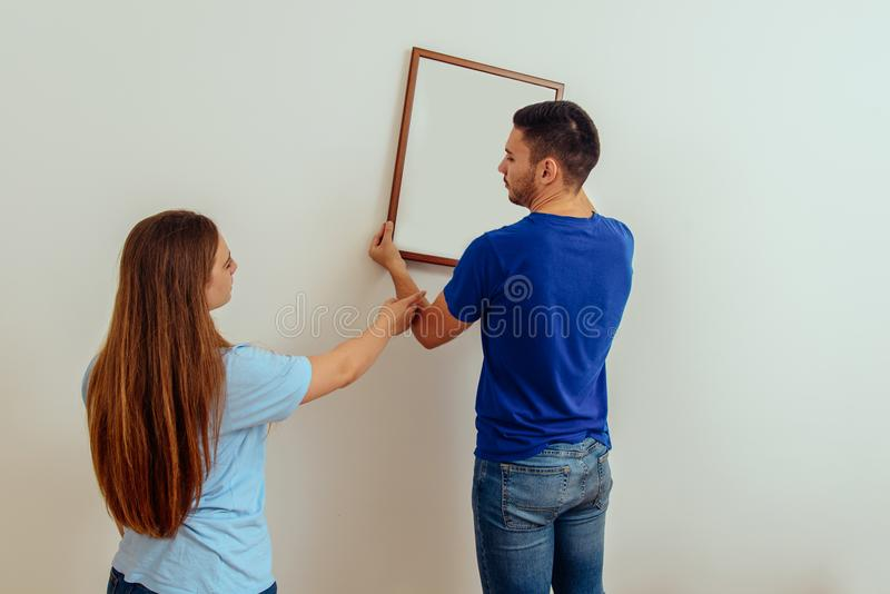 A young married couple decorates their new home stock image