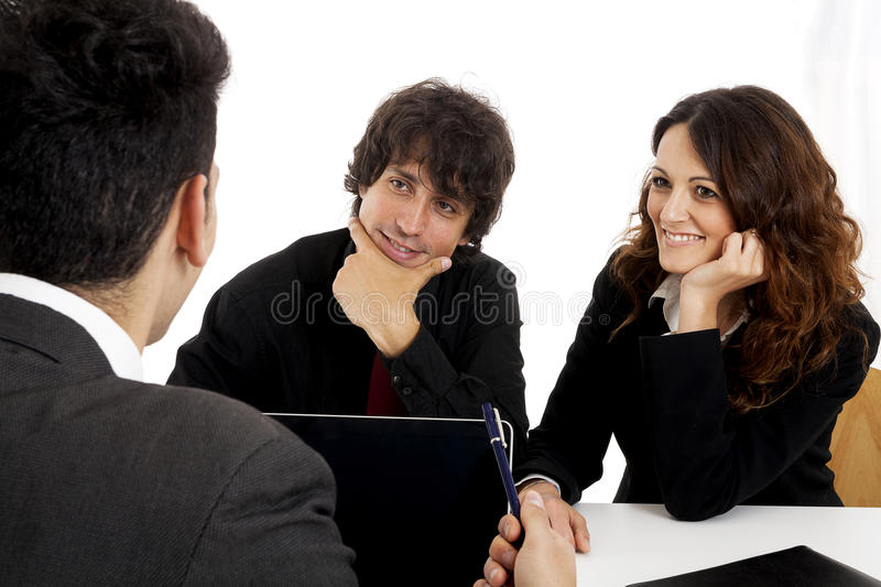 Young married couple at desk. In a business meeting stock photo