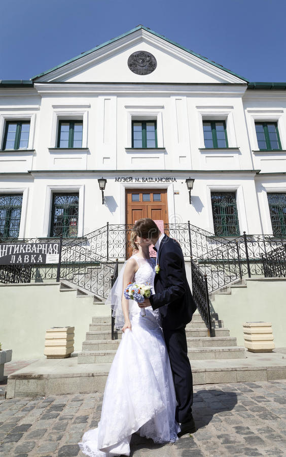 Young married couple, kissing next to architectural site royalty free stock image