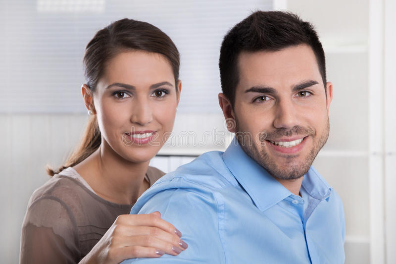 Young married couple in the office making plans for retirement a. Young newly married couple in the office making plans for retirement and future stock photography