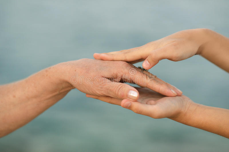 Young with mature Hands. Together close up stock images