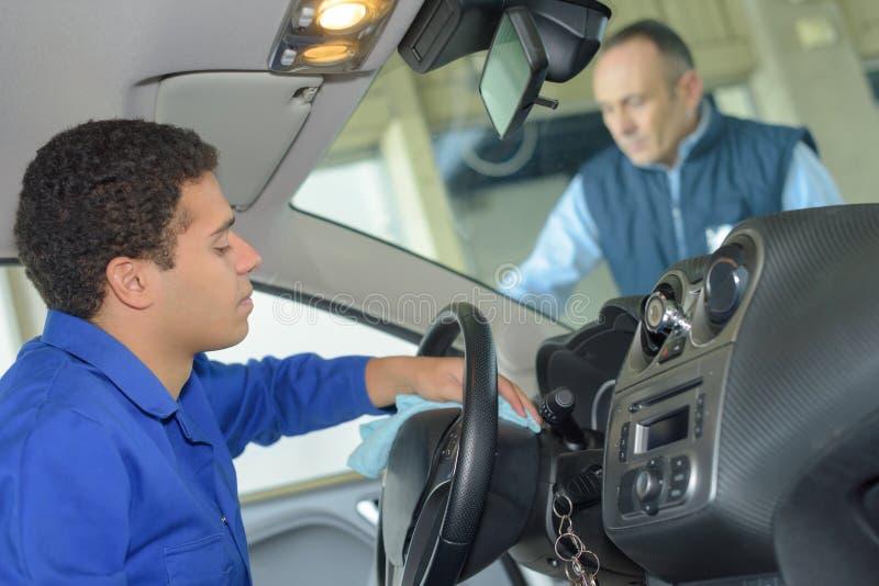 Young mechanic turning on engine royalty free stock photos