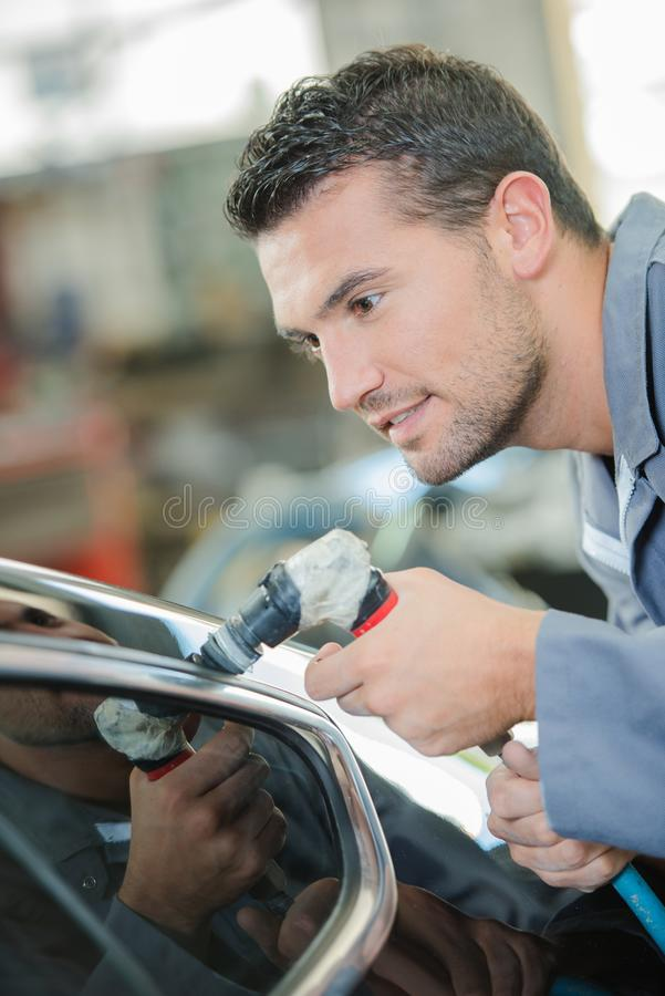 Young mechanic at work royalty free stock photography