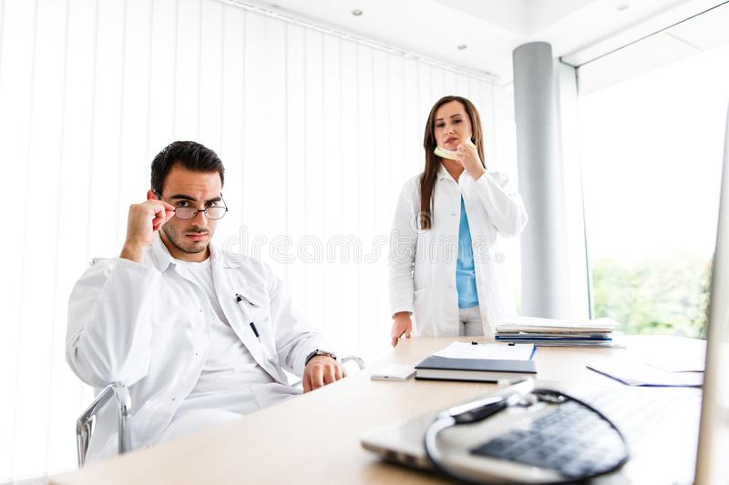 Young Medical Colleagues Working On Laptop stock image