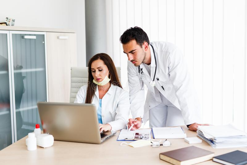 Young Medical Colleagues Working On Laptop royalty free stock image