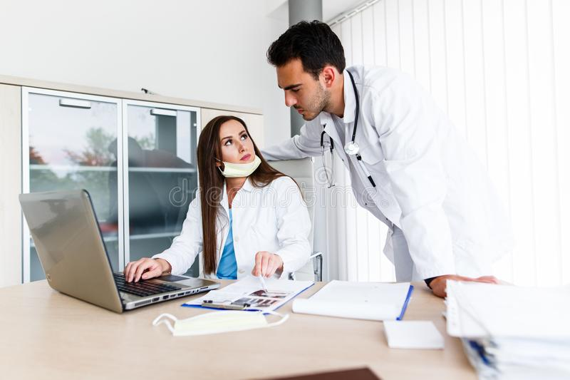 Young Medical Colleagues Working On Laptop stock photography