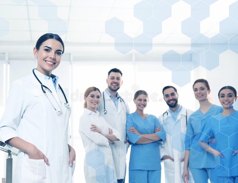 Young medical doctor with colleagues. In clinic royalty free stock images