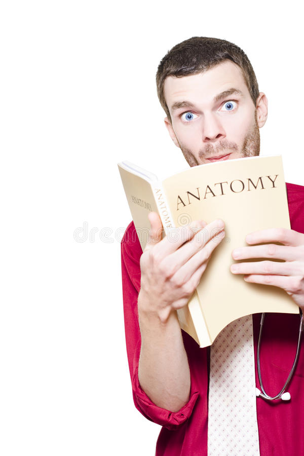 Download Young Medical Intern Student Studying Anatomy Book Stock Images - Image: 27490414