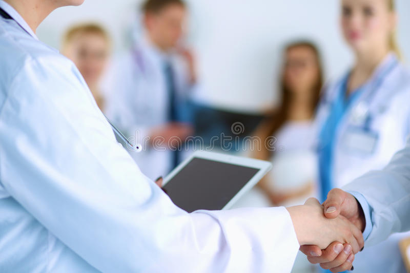 Young medical people handshaking at office.  royalty free stock photo