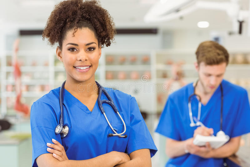 Young medical student smiling at the camera royalty free stock photos