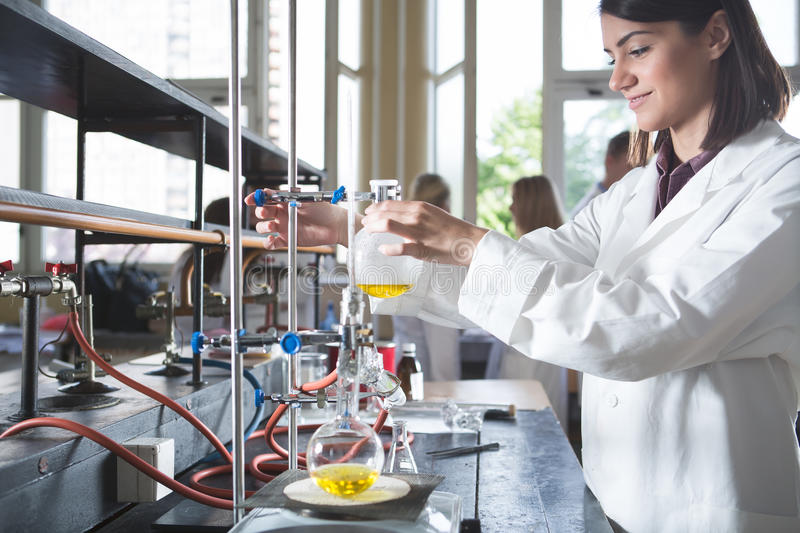 Young medicine developer pharmaceutical researcher.Woman genius chemist.University professor.Intern.Developing new medicine for p. Sychosis and depression in stock image