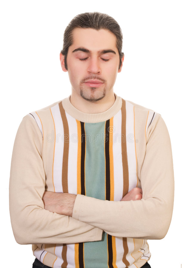 Young meditating handsome male in sweater isolated stock photo