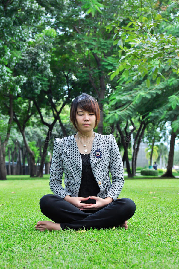 Young meditation woman in nature royalty free stock photo