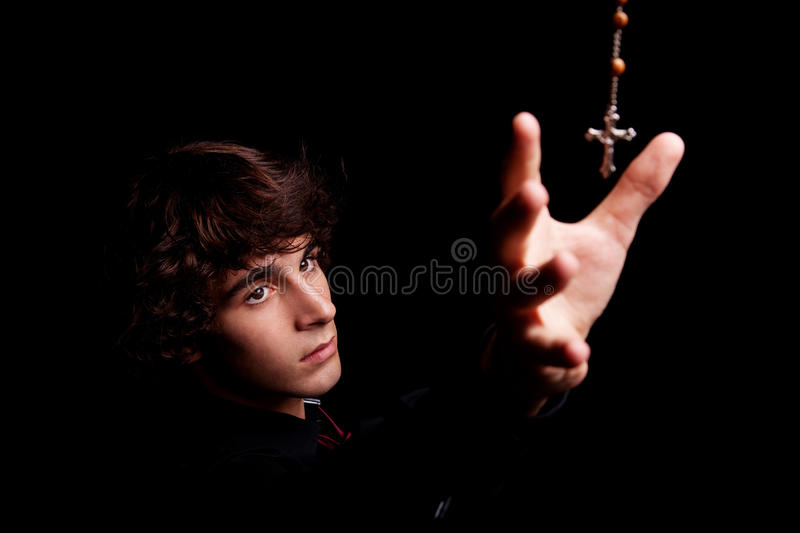 Download Young Men, Arm Raised, Trying To Grab A Crucifix Stock Photo - Image: 16299438