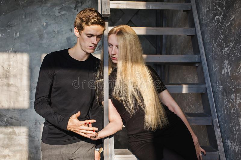 A young man and young blonde woman with long hair stock photo