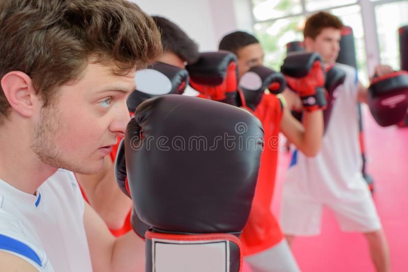 Young men in boxing class royalty free stock photo