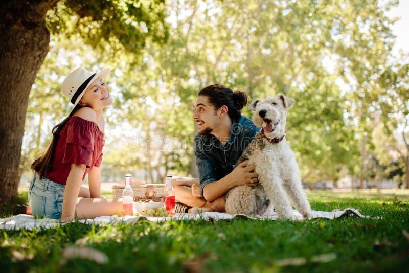 Couple having fun on picnic stock photos