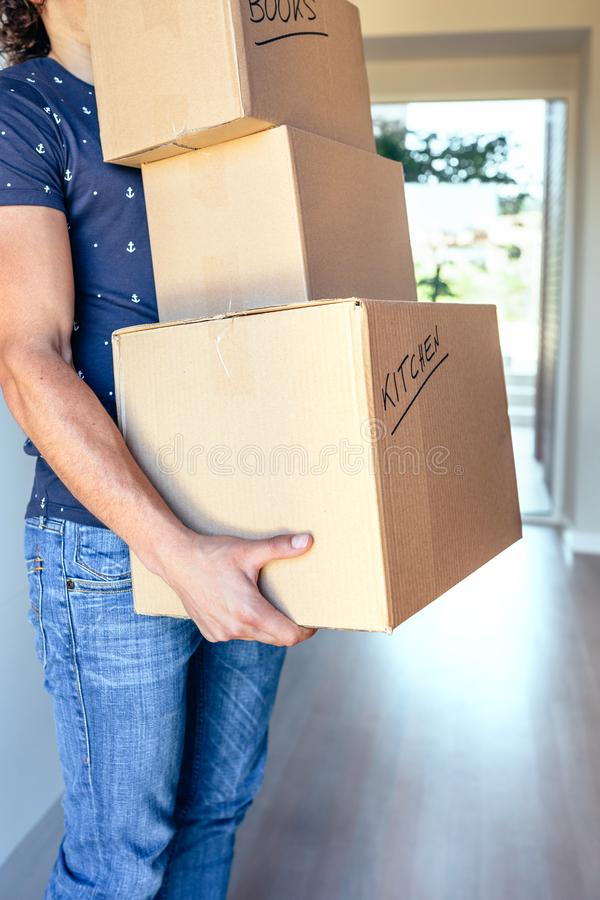 Man carrying moving boxes stock image