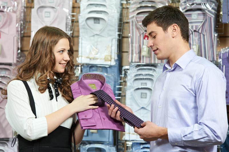 Man and assistant at apparel clothes shopping stock image