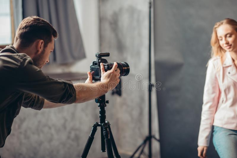 Young man concentrated on making a photo royalty free stock image