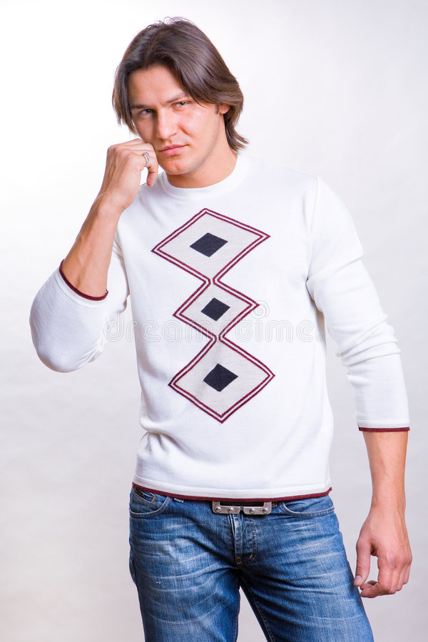 Young Men Dressed In A Sweater And Jeans Stock Photo