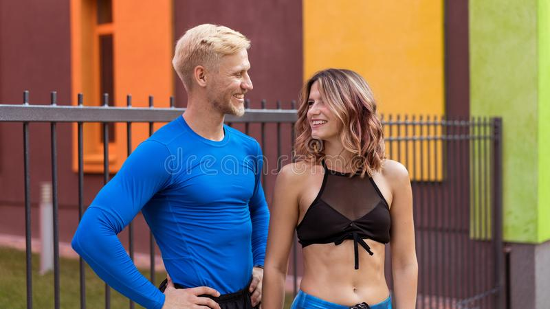 Young man and girl after jogging having a rest royalty free stock photography