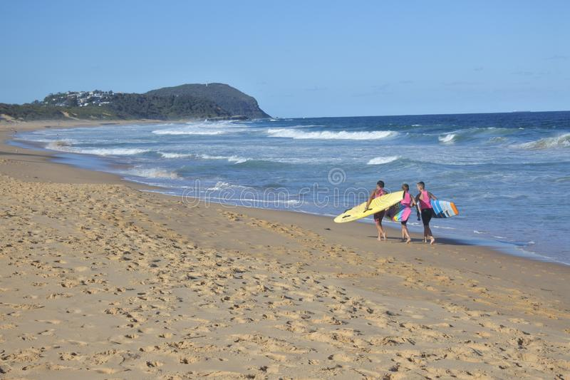 Young men going to surfe in Central Coast in New South Wales Australia. Young men going to surfe in Central Coast in New South Wales, Australia.Wave surfing is royalty free stock photos