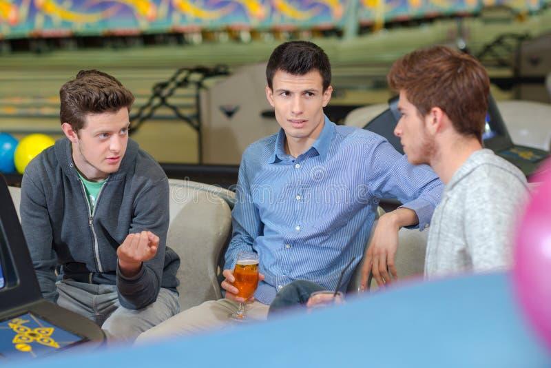Young men having drink stock photos