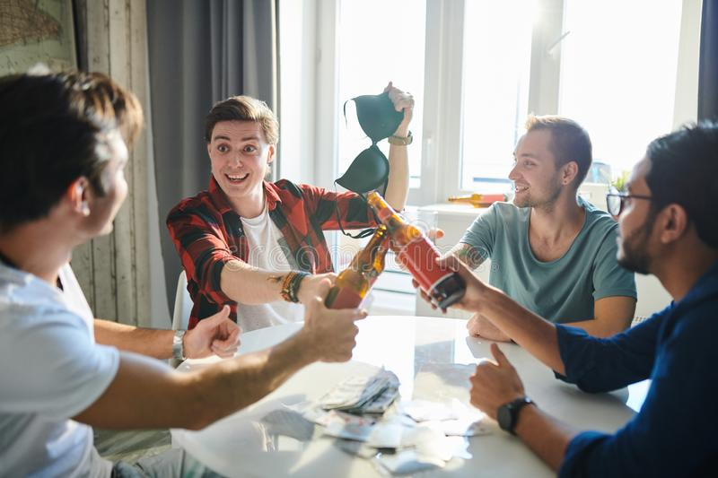 Men sitting at home stock photography