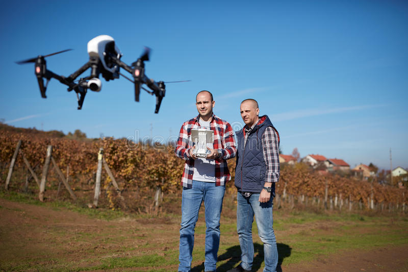 Young men manages drone`s flight. Two young men wireless manages drone`s flight royalty free stock photography