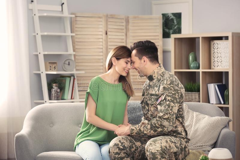 Young man in military uniform with his wife royalty free stock image