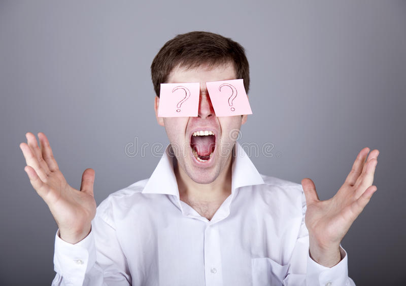 Download Young Men With Notes On Eyes. Stock Image - Image of mark, people: 18318895