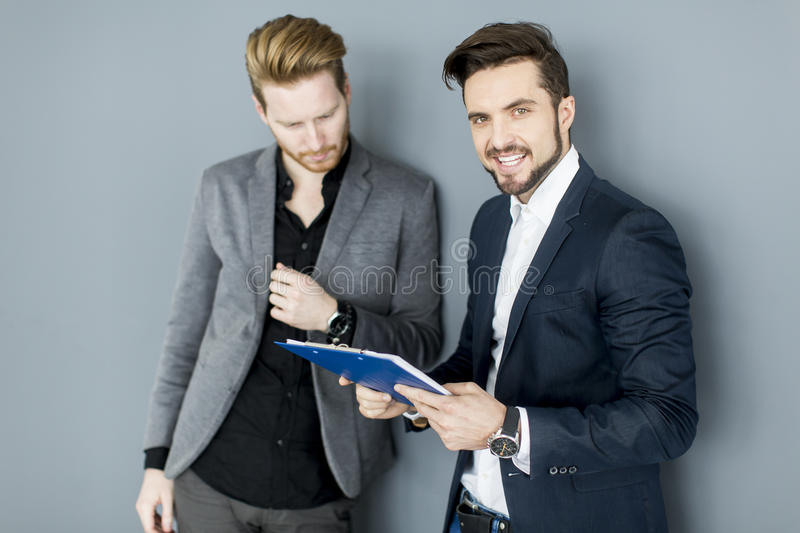 Young men in the office stock photos