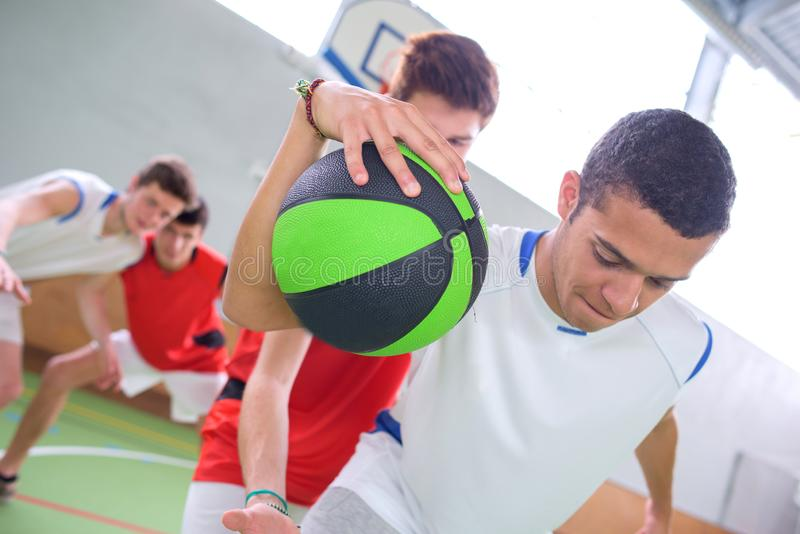 Young men playing basketball royalty free stock photo